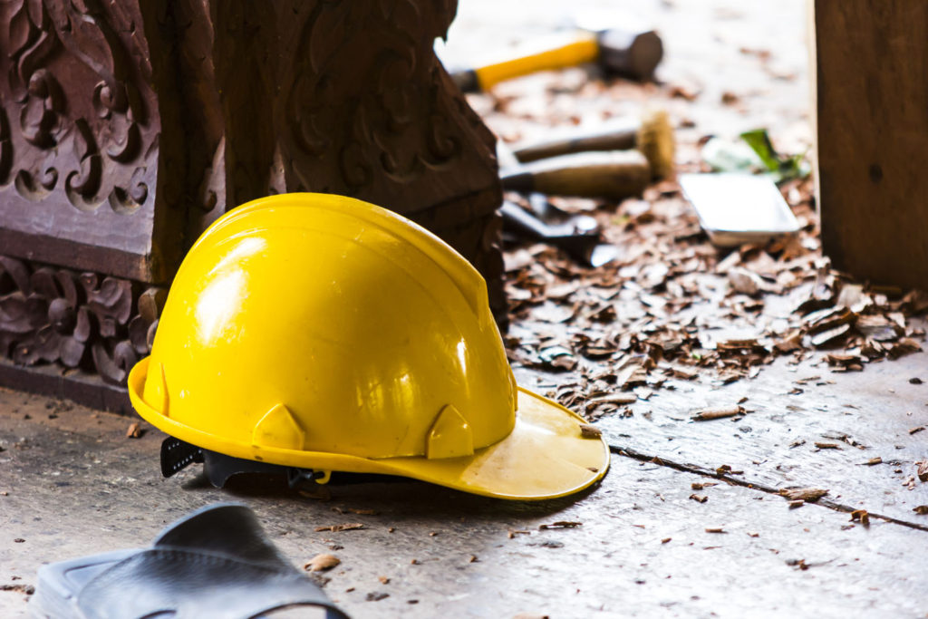 Hard hat on the floor of a construction site