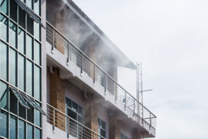 Smoke exiting the front of a high rise building